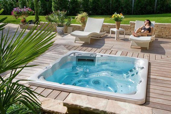 Jacuzzis et spas en basse normandie baln oth rapie delalande piscines - Spa integre dans terrasse ...